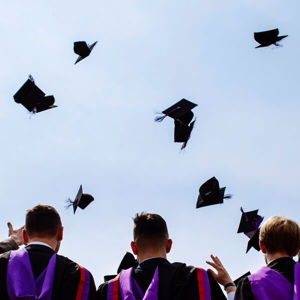 Graduates throwing hats