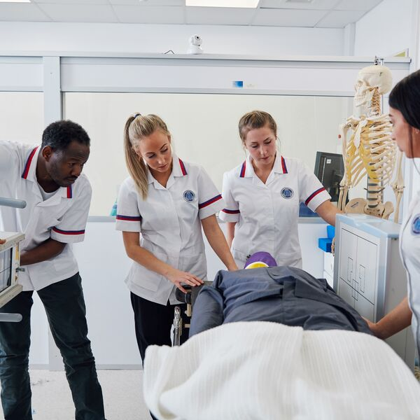 four students in the school of health and care professions