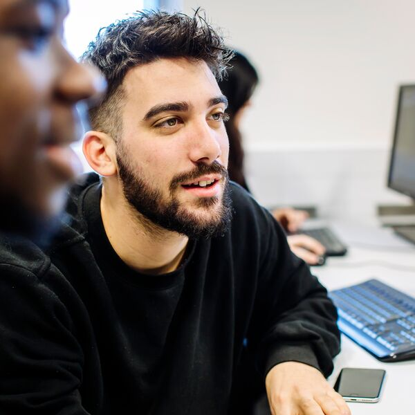 Male University of Portsmouth student using computer in Business School