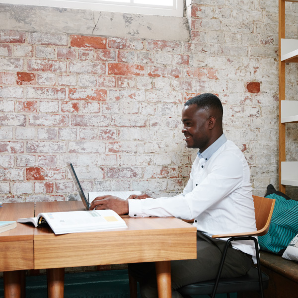 Man working at fixed desk space at Cell Block Studios