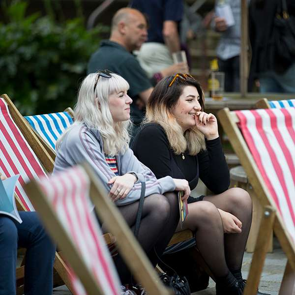 Students and members of the public sat in deck chairs at University