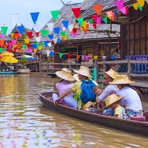 Tourists on river boat in SE Asia