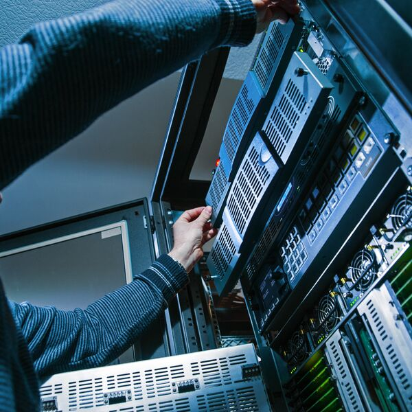 Man working with servers in server room