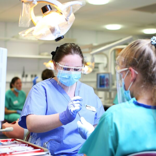 Dental professionals working in a dental surgery
