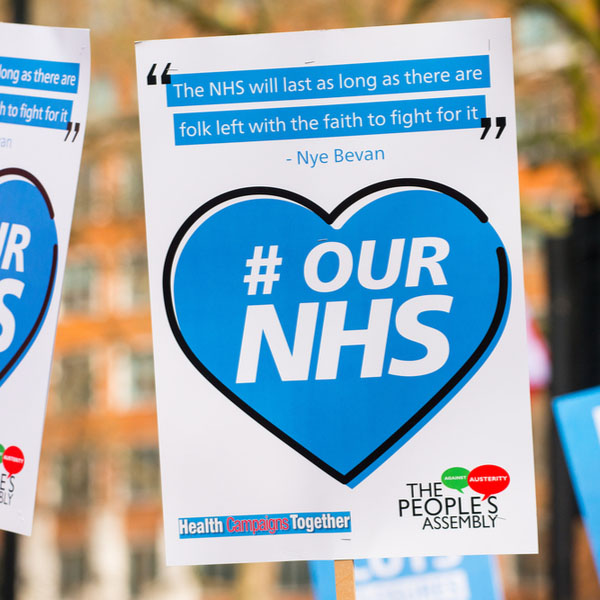 NHS placard at London demonstration