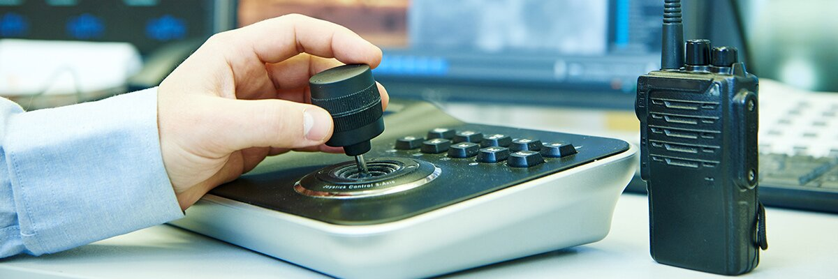 Security management operative uses a camera joystick