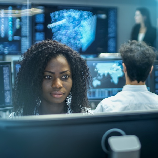 Female cyber security worker working at computer