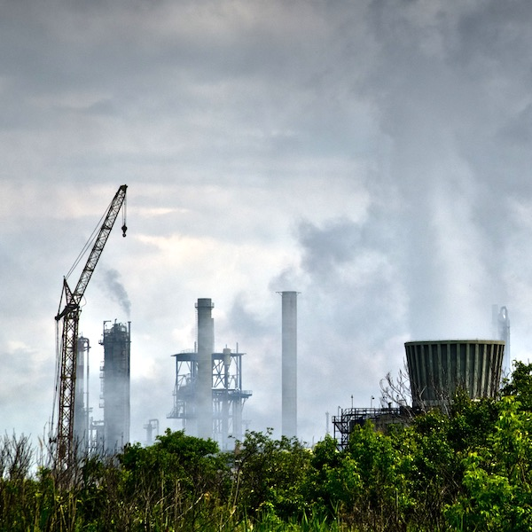 pollution from factory rising into a dark grey sky