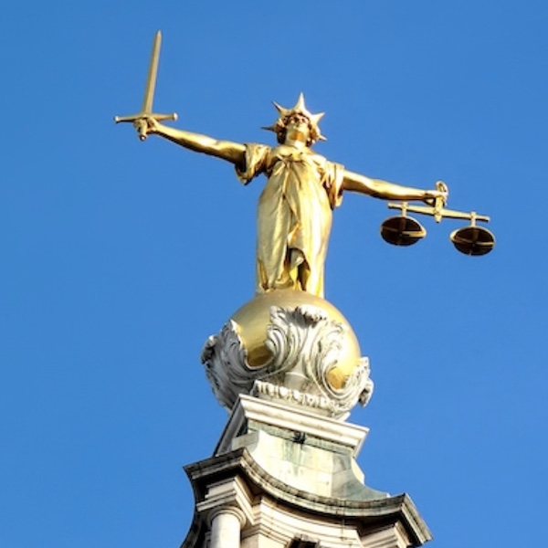 Statue on top of law courts, London