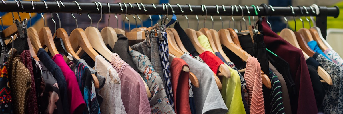 Stock image of vintage clothes in charity shop
