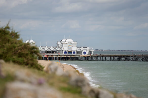 Wide view of Clarence Pier with sea in background