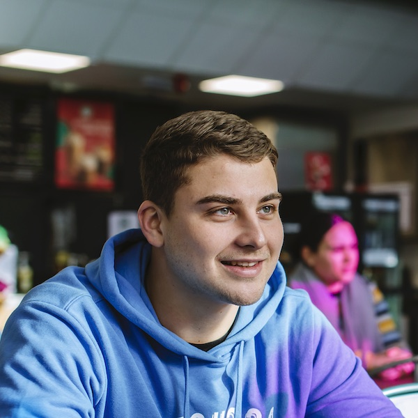 Male University of Portsmouth student socialising in a cafe