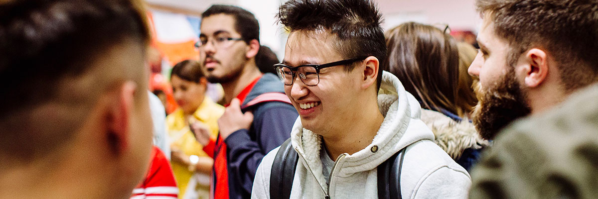 male student from singapore laughing at festival of cultures 2017