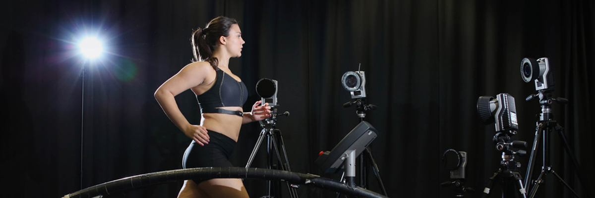 Female runner using treadmill with motion capture equipment