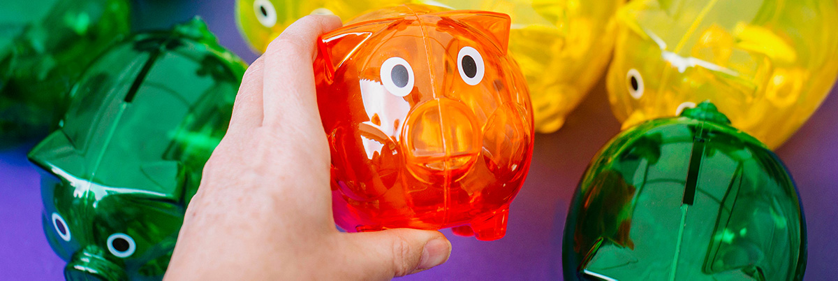 Person holding University of Portsmouth coloured piggy banks
