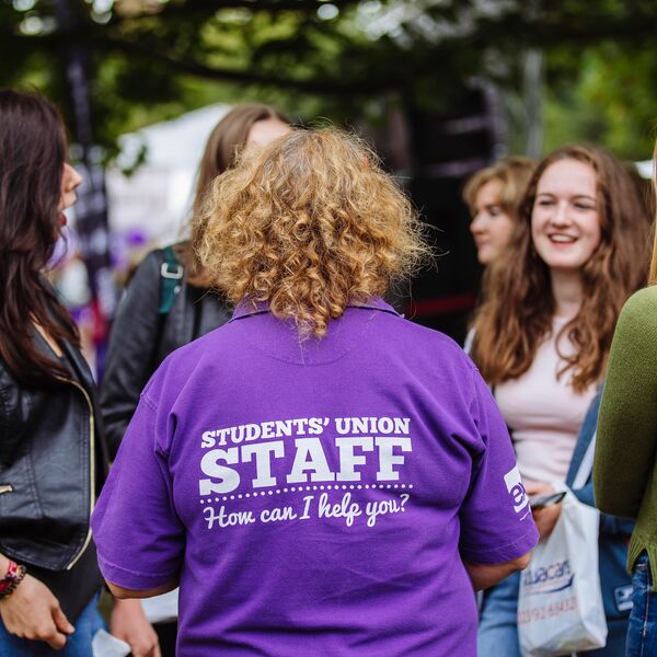 University of Portsmouth student union volunteer speaking to new students