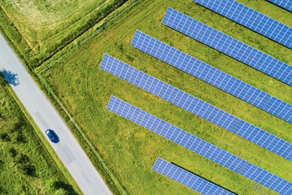 Aerial of solar panels in field