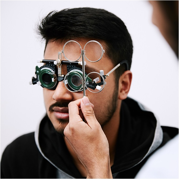 Patient having an eye test wearing a trial frame